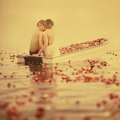 boating in a lake full of flower petals, romantic & fairytale-like