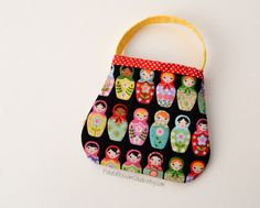 Adorable, lovable toddler purses.  The quilting on these is irresistible.   Potato Blossom Studio, handmade on Etsy.