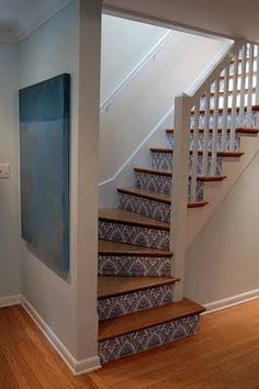 stairs - similar to this going into the basement, but put a slide going through the wall for the kids