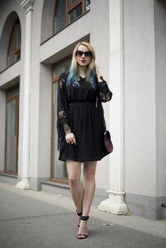 Shop this look on Lookastic:  https://lookastic.com/women/looks/kimono-party-dress-heeled-sandals/13969  — Black Sunglasses  — Black Tulle Party Dress  — Black Lace Kimono  — Black Suede Heeled Sandals  — Brown Bracelet  — Dark Purple Leather Crossbody Bag