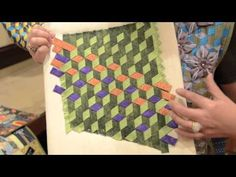 Rami Kim shows weaving technique from her new AQS book Elegant Cotton Wool Silk Quilts. This is SO cool!! Check it out. Wonderful way to do tumbling blocks without worry about points matching.