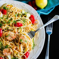 Garlic Prawn Spaghetti with Lemon, Zucchini and Cherry Tomatoes. It is a lovely, light and a zesty dish. A perfect Summer Pasta.