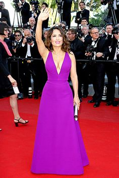 Salma Hayek stunned in a bright purple piece featuring a plunging V-shaped neckline at the red carpet premiere of Carol on May 17, during the 68th annual Cannes Film Festival.