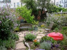 Simple Small Backyard Garden House Design With Stone Floor Tiles Vegetable Plants And Flower Plus Old And Vintage Rocking Chair With Bench Beside Potted Plants Ideas, Backyard Garden Design Garden and Patio No Grass Backyard, Backyard Garden Landscape, Small Backyard Gardens, Modern Backyard, Backyard Ideas, Rustic Backyard, Landscaping Ideas, Backyard Decorations, Patio Gardens