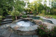 what a beautiful back yard with pool and hot tub.