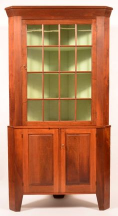 "Sold $2,000  Pennsylvania Country Federal Walnut Two Part Corner : Pennsylvania Country Federal Walnut Two Part Corner Cupboard. Molded cornice, single 16 pane glazed upper door above two raised paneled lower doors and high cut out feet. 85""h. x 45""w. x 20""d. Condition: Very good."