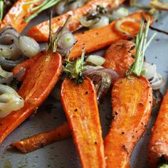 Roasted Carrots with Shallots & Thyme  Ingredients: 2 pounds carrots,1 cup sliced shallots,2 teaspoons fresh thyme,3 tablespoons extra-virgin olive oil,Coarse salt &ground black pepper  Directions:Preheat oven to 425° F. Place rack in center of oven.Peel carrots if desired & trim green top, leaving about 1/2–inch. Cut larger carrots in 1/2 lengthwise & place in a rimmed baking sheet. Add shallots and thyme; drizzle with oil & stir to coat.Season w/ salt & pepper. Roast for about 30-35 mins