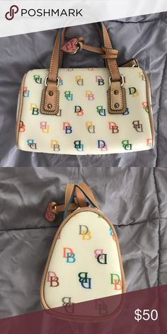 VINTAGE Dooney and Bourke purse Barely used. No damage. Dooney & Bourke Bags Mini Bags