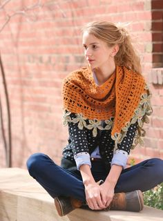 This crescent-shaped crochet wrap hugs your shoulders while a swath of dangling leaf motifs swirls with every step. The wrap is worked directly to the leafy trim with a join-as-you-go crochet technique, giving the stems a jaunty curve.
