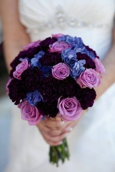 Modern bridal bouquet made of different purple flowers
