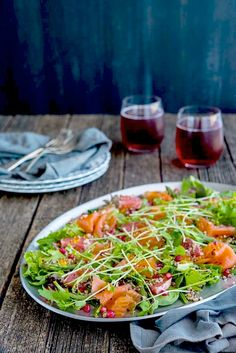 A beautiful, blush-coloured salmon salad. The pomegranate seeds and salmon caviar look like little jewels.