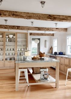 Wood beams Wood cabinets Subway tile ❤️