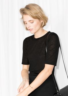 With a luxe wool mix, this top has a classic t-shirt fit.