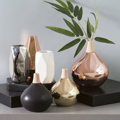 Tesla Vase | Pillow Talk. Mix your metals and textures for added interest and a glam look.