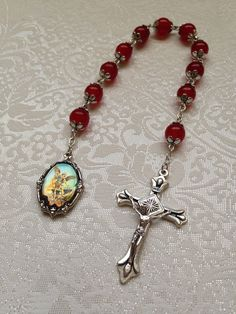 St Michael Red Jade one decade catholic pocket rosary on Etsy, $15.00