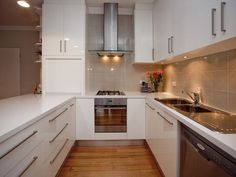 This u style kitchen is very efficient for using a small space and still looking good.