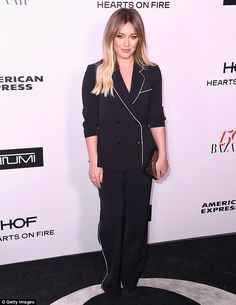 Chic: The 29-year-old actress donned a two-piece black pantsuit set with white trim at the...