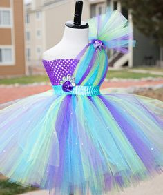 Another great find on #zulily! Blue & Purple Peacock Galore Dress - Infant, Toddler & Girls by Tutu's Galore #zulilyfinds