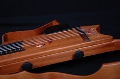 Lardy Fatboys Chordophone of the Day — AJL Guitars silent travel guitar for gypsy swing...