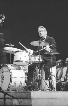 Gene Krupa ----Neil went to this guy to learn more about the art of drumming when Neil was already a great drummer!