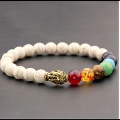 """Ladies Chakra Reiki Buddha Prayer Bead Bracelet An 8mm beaded white turquoise semi precious stone elasticized bracelet. Contains Seven colors of the chakra, reiki healing prayer beads with gold Buddha. Great for bringing balance and peace into your life. Measures approx 7"""" in length. Brand new! Jewelry Bracelets"""