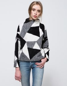 From Stelen, a soft mid weight popover sweater with geometric pattern in Black.  Features short stand collar, full length sleeves, dropped sleeves, slightly tapered cut, invisible zipper back and relaxed fit.  • Soft, mid weight woven sweater in Black