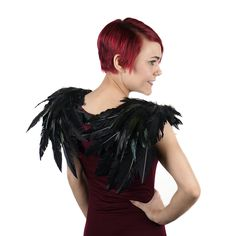 Over the Shoulder Crow Feather Wings measure approximately 27x19 inches and are made with dyed Rooster Schlappen and Turkey Quill Feathers. Made to be flexible over the shoulder, the wing span can be