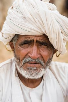 Rabari man wearing traditional earrings and white turban. Gujarat, India.