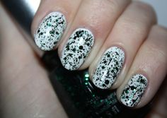 China Glaze Graffiti Glitters - bold emerald green glitter with black Bitz  'N' Pieces. Click the photo to see the full swatch review on Polish You Pretty!