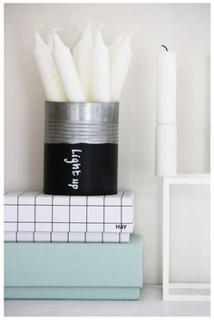 Chalkboard painted tin cans for storage  @sheila @ tasteduds Rogers....much better than GLASS jars. Save those cans!