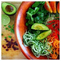 Spiralized cucumber and carrot * Red Bell Pepper * Alfalfa * Green Onion * Sesame Seed * Avocado * Dried Cranberries * Dressing = Lime + Coconut Oil + Himalaya Pink Salt + Side of Oranges #raw #vegan #healthy #food