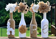 Upcycled jute / twine / yarn wrapped wine bottles featuring handmade roses spelling out Hope via Etsy