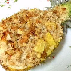 """Gratineed Pineapple -- a baked pineapple, stuffed with coconut, crushed gingersnaps, macadamia nuts, sweetened condensed milk and a bit of rum. Allegedly tastes like """"Hawaii on a plate"""" Baked Pineapple, Pineapple Desserts, Pineapple Recipes, Fruit Recipes, Dessert Recipes, Cooking Recipes, Pineapple Coconut, Coconut Rum, Delicious Desserts"""