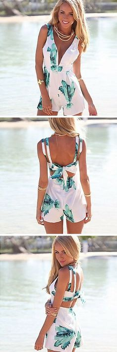 Sleeveless V-neck tropical print romper. That palm leaf print is so stylish for summer! Pack this affordable romper for your next vacation. It's sexy and flirty without showing too much skin. Notice the gorgeous bow back!