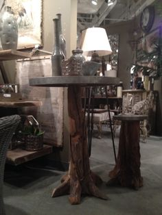 A high table with dark wood along with more silvers and metals #homedecor #interiordesign #accessories #furniture