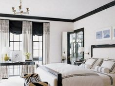 finally found a picture...white walls and black molding...think I am going to do this