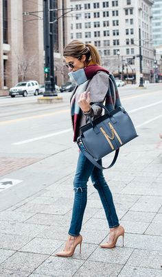 Nude patent heels and blue handbag