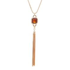 Topaz and tassels are a timeless marriage made in heaven. The assertive Tess necklace features an over-sized octagonal topaz stone as its centerpiece, bordered in braided gold and plunging towards cascading tassels. You'll be un-missable wearing the on-trend Tess.   Find it on Splendor Designs