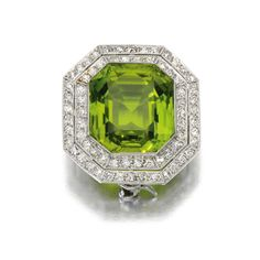 SOTHESBY'S JEWELS ~ Peridot and diamond brooch, 1910s