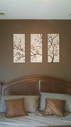painted tree canvases above the bed. With buttons!