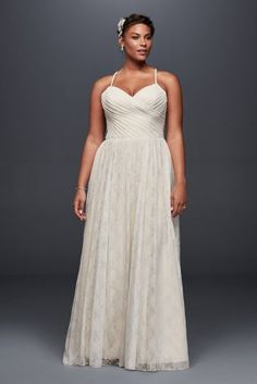 A simple and airy plus size lace wedding dress, beautifully pleated at the sweetheart bodice before flowing into a floor-skimming skirt.   Galina, exclusively at David's Bridal  Plus Size  Polyester  Sweep train  Back zipper; fully lined  Dry clean  Imported  Also available in regular, extra length, and plus size extra length