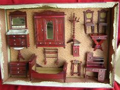 Antique Schneegas bedroom set in original box. Schneegas was a German company that produced fine wood dollhouse furniture around the turn of the century.