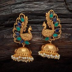 Jewelry Set Designer peacock earrings studded with synthetic blue and green stones, plated with gold polish and made of copper alloy Gold Jhumka Earrings, Indian Jewelry Earrings, Peacock Jewelry, Jewelry Design Earrings, Gold Earrings Designs, Gold Jewellery Design, Antique Earrings, Bracelet Designs, Antique Jewelry