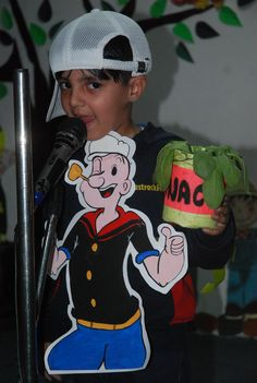 At Nursery Recognition Day child imitating Popeye character