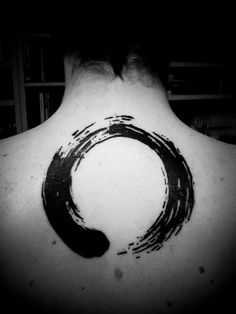 Enso tattoo. Would almost consider incorporating an enso into the koru i have on my shoulder.