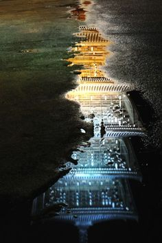 thekimonogallery:  Reflection in puddles of Zentsu-ji temple, Kagawa, Japan.  Photography bu nao on Ganref
