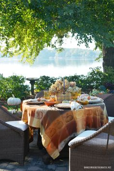Pumpkins and Plaid Alfresco Fall Table by the lake | homeiswheretheboatis.net #fall #tablescape #pumpkins