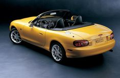 2002 Mazda Miata Special Edition. This car makes me happy. Not trading it in any time soon.