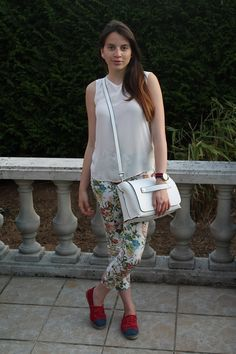 Marry a white chiffon sleeveless top with white and green floral skinny pants and you'll look like a total babe. Red canvas espadrilles will contrast beautifully against the rest of the look.   Shop this look on Lookastic: https://lookastic.com/women/looks/sleeveless-top-skinny-pants-espadrilles/12634   — White Chiffon Sleeveless Top  — White Leather Crossbody Bag  — Red Canvas Espadrilles  — Red and Navy Horizontal Striped Watch  — White and Green Floral Skinny Pants