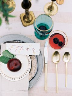 Red, blue and gold table setting perfect for fall and winter